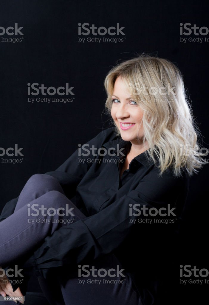 Woman With Blonde Lob Haircut On A Black Background Stock Photo