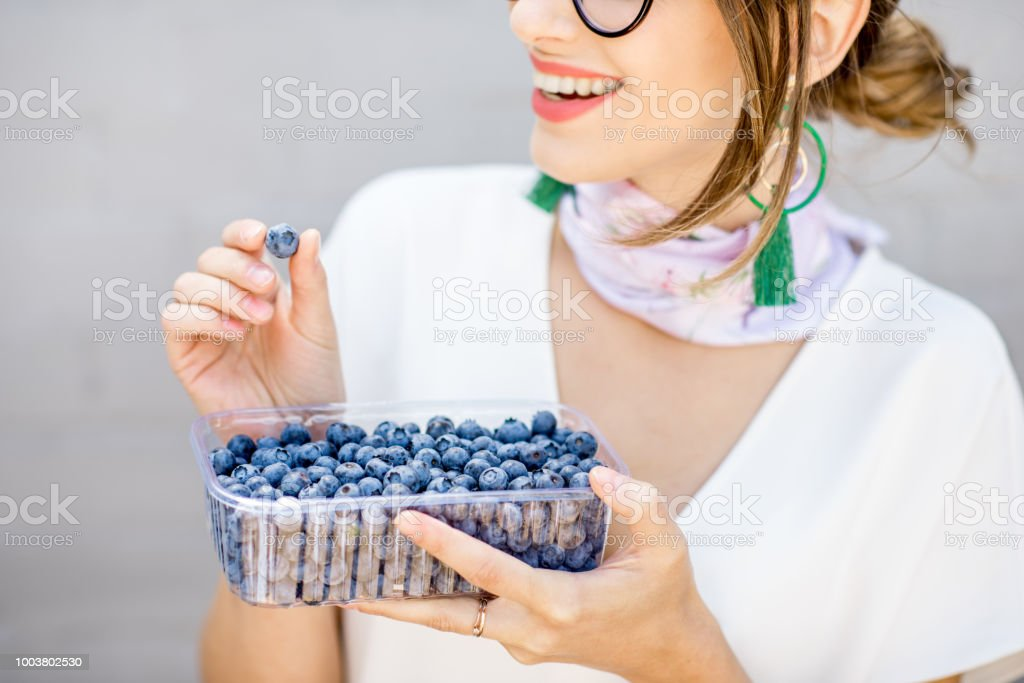Woman with bluberries stock photo