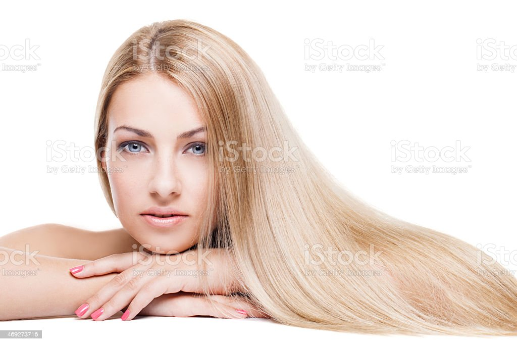 Woman with blue eyes and long blonde hair  stock photo