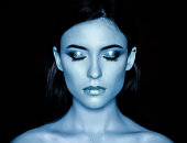 Woman with blue make-up.
