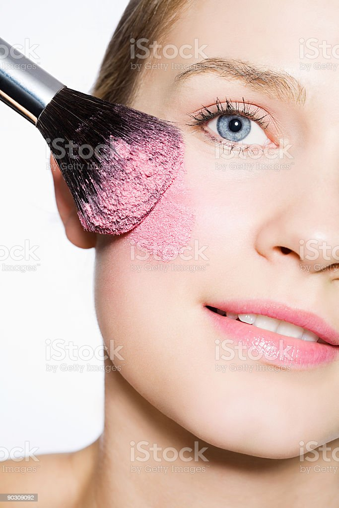 Woman with blusher on cheek stock photo