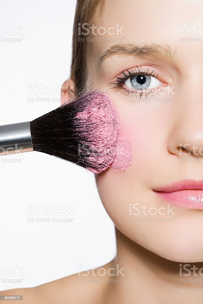 Woman with blusher on cheek royalty-free stock photo
