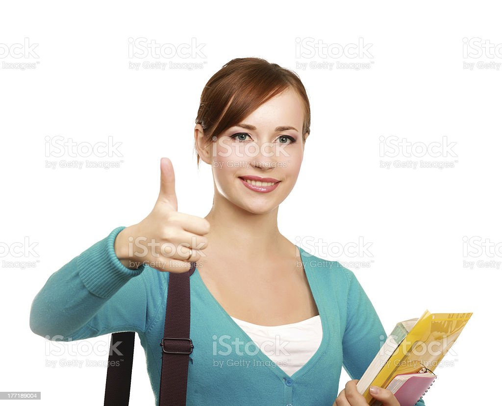 Woman with books showing thumb up royalty-free stock photo