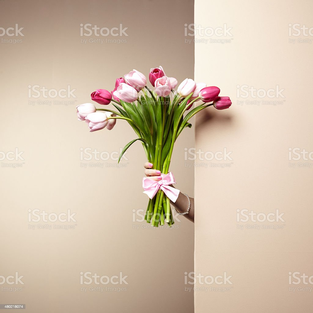 Woman with bouquet of flowers in her hands stock photo