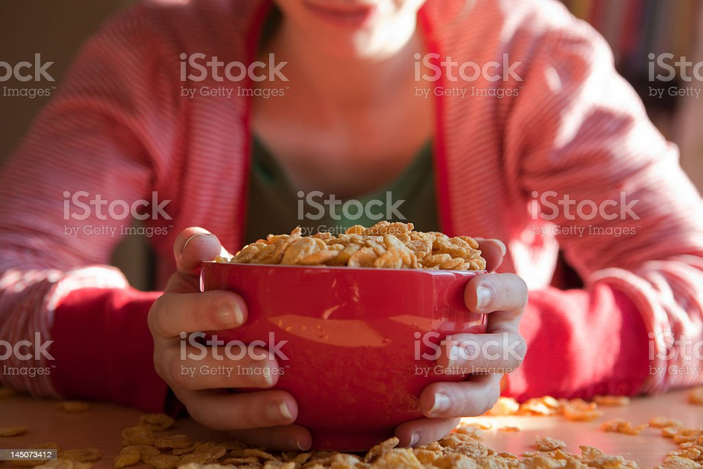 Woman with bowl and spilt breakfast cereal stock photo