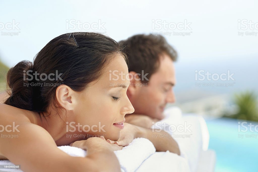 Woman with boyfriend lying at spa royalty-free stock photo