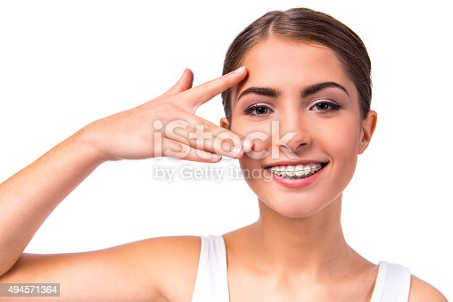 istock Woman with braces 494571364