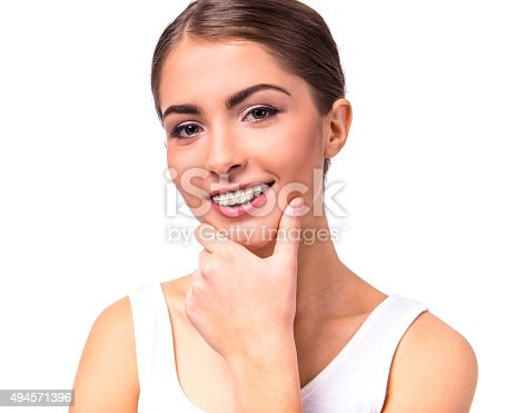 istock Woman with braces 494571396