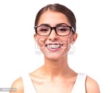 istock Woman with braces 494571428