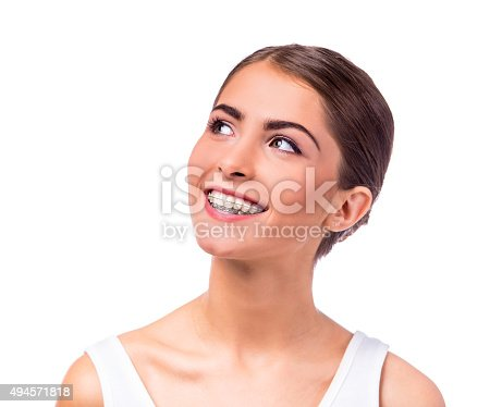 istock Woman with braces 494571818