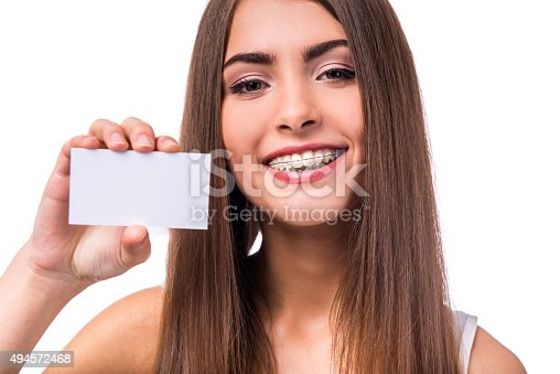 istock Woman with braces 494572468