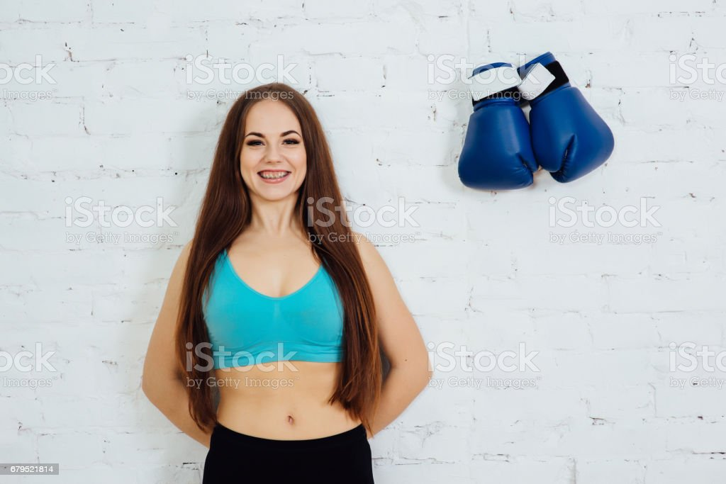 Woman with braces resting after a workout royalty-free stock photo