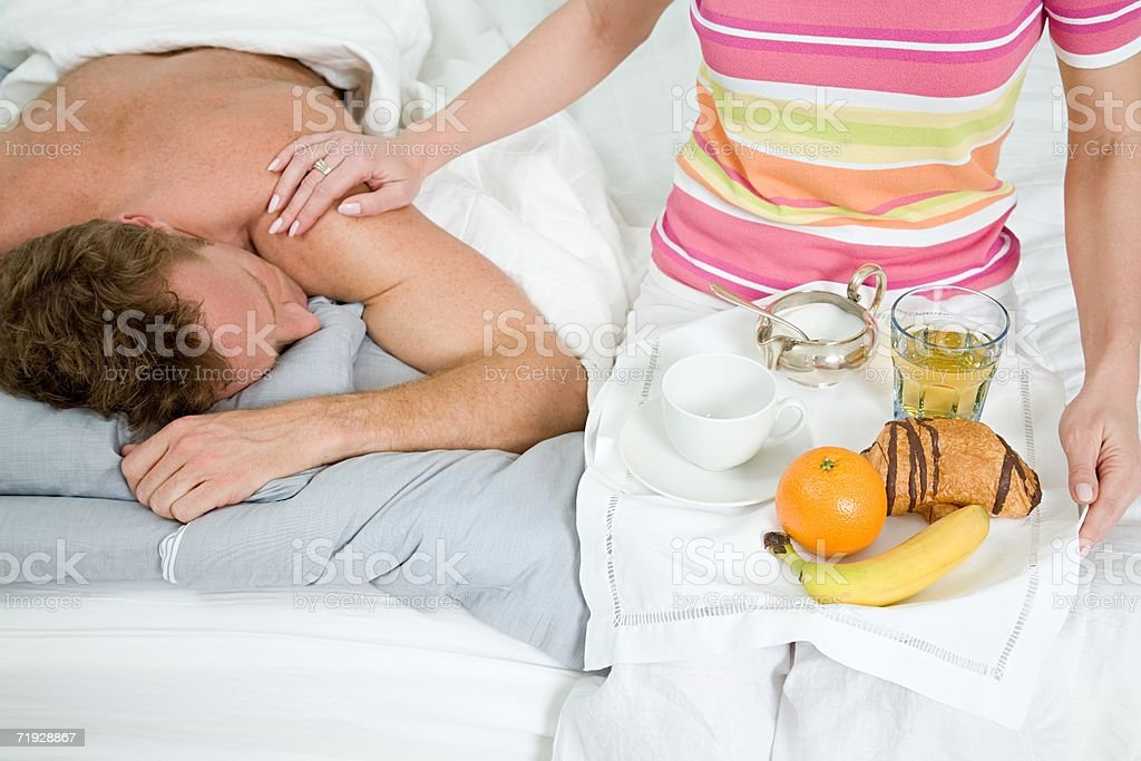 Woman with breakfast for husband royalty-free stock photo