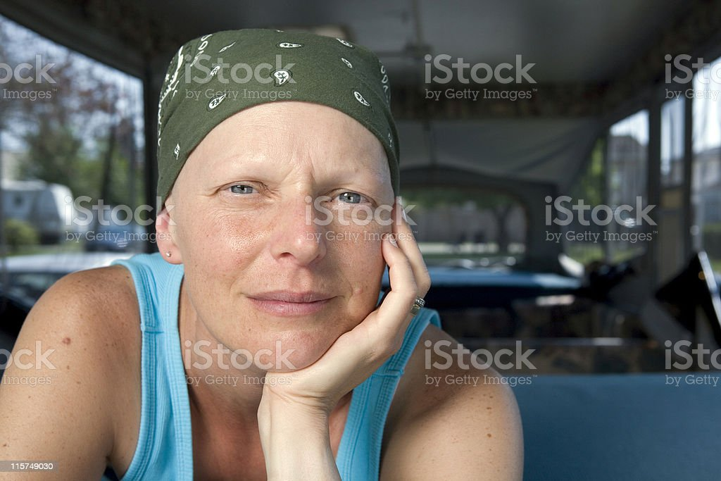 Woman with breast cancer wearing a scarf on her head stock photo