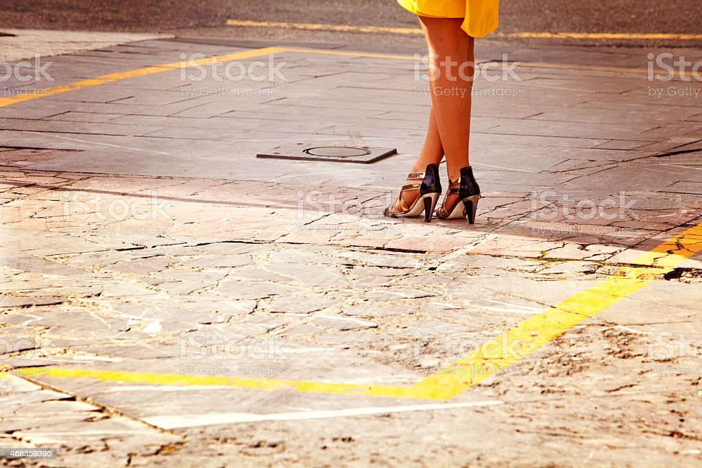 Woman with bright heels and yellow dress royalty-free stock photo