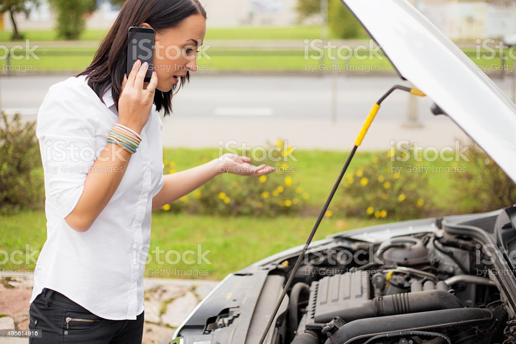 Woman with broken car stock photo
