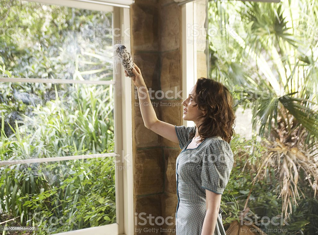 Woman with burning incense royalty-free stock photo