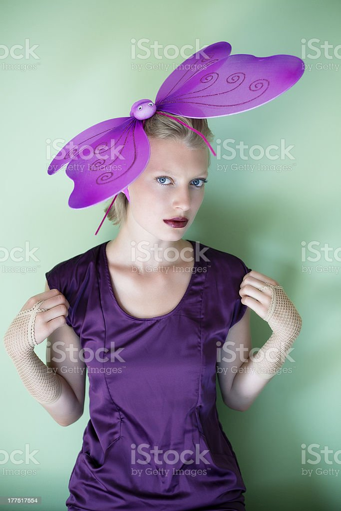 Woman with butterfly hat stock photo