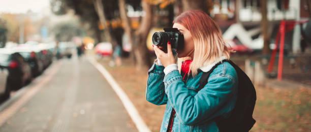 Woman with camera taking picture in the street picture id1085356470?b=1&k=6&m=1085356470&s=612x612&w=0&h=njagk yikqevtdpvdauohfafdr2rh hjyva3jlyknze=