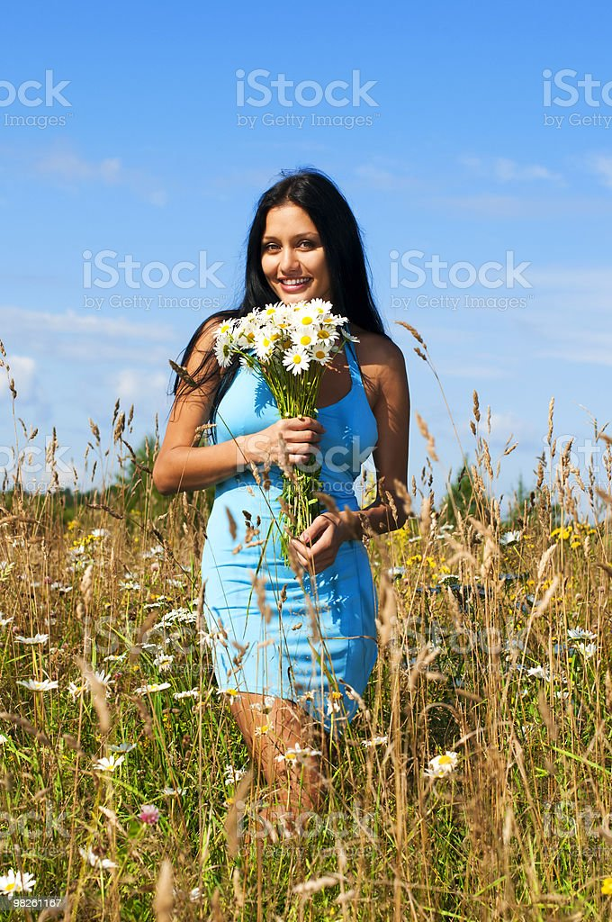 Woman with camomiles royalty-free stock photo