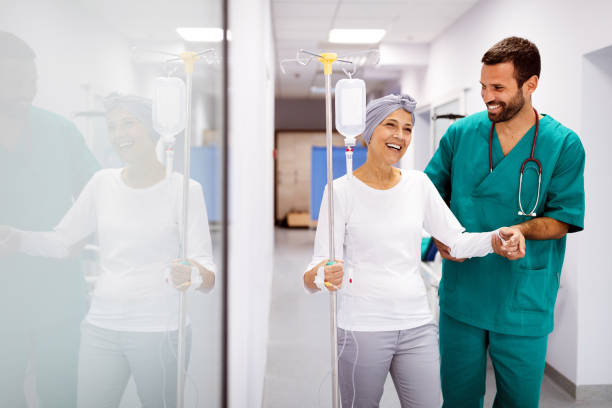 Woman with cancer during chemotherapy recovering from illness in hospital stock photo