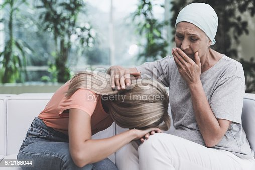 istock A woman with cancer is sitting on a white sofa in a modern clinic. Next to her sits her daughter. 872188044