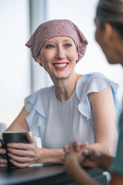 woman with cancer meeting with female physician - foulard copricapo foto e immagini stock