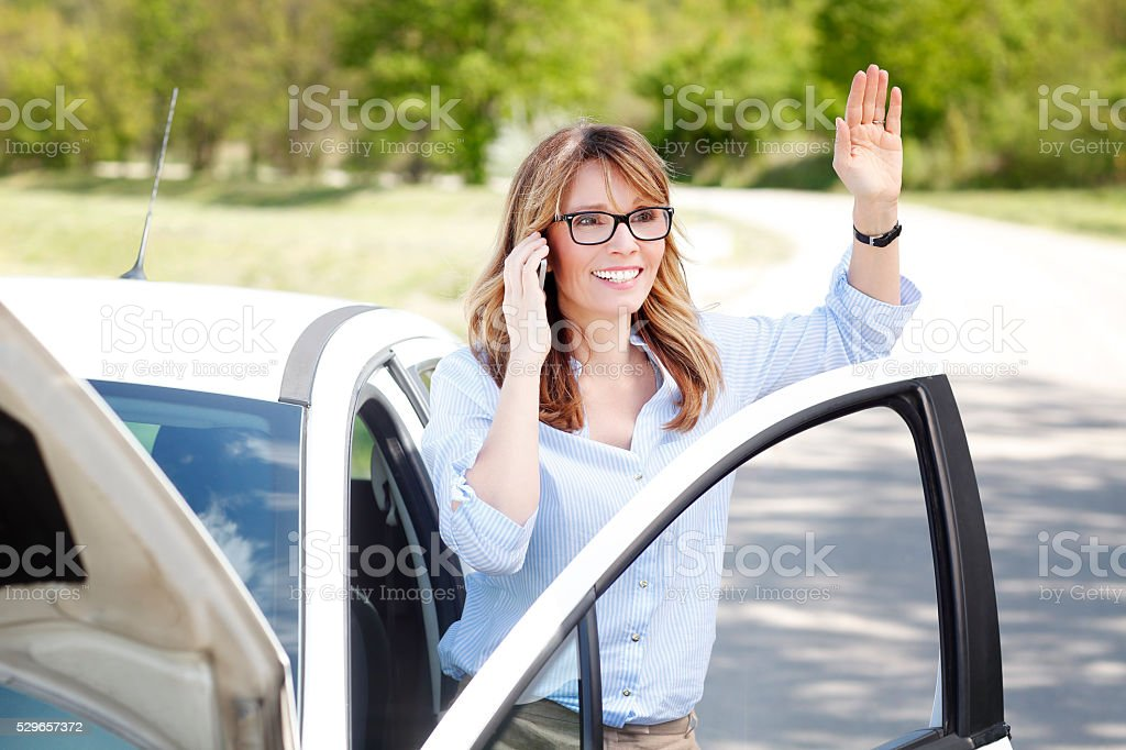 Woman with car on the road stock photo