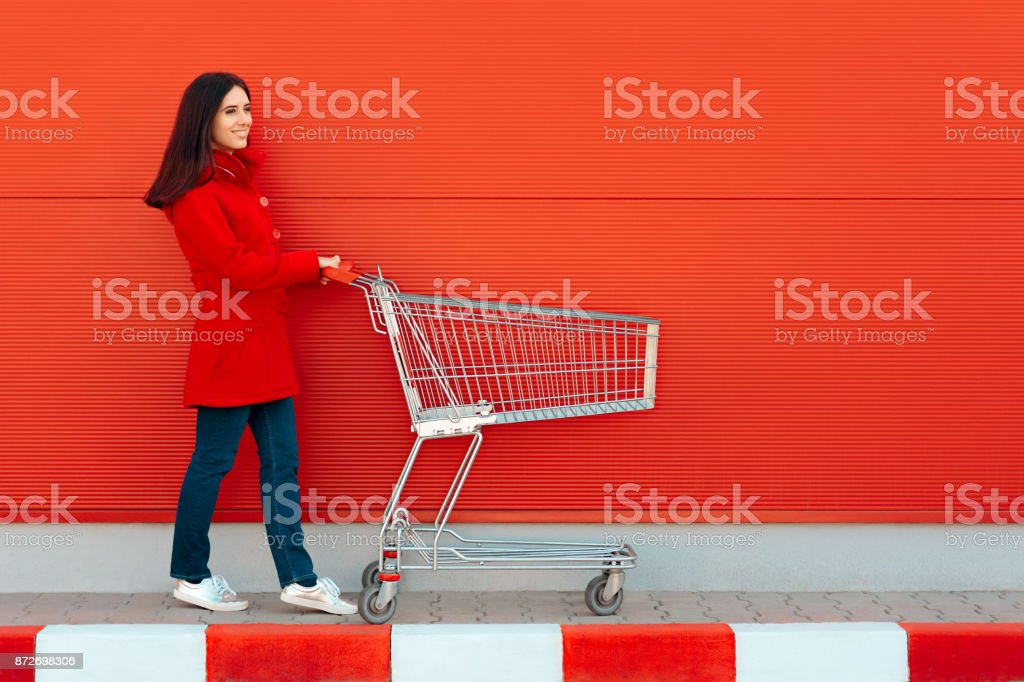 Woman with Cart Ready for Shopping Spree on Sale Season stock photo