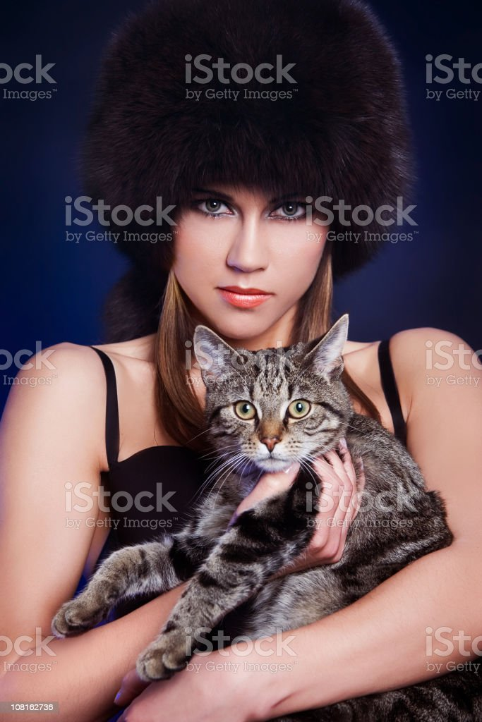 woman with cat on hands royalty-free stock photo
