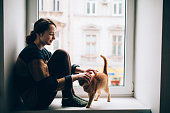 istock Woman with cat 601392466