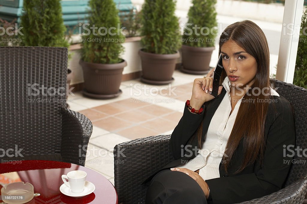 Woman with Cellphone in cafe royalty-free stock photo