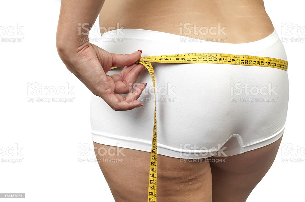 Woman with cellulite measuring her buttocks stock photo