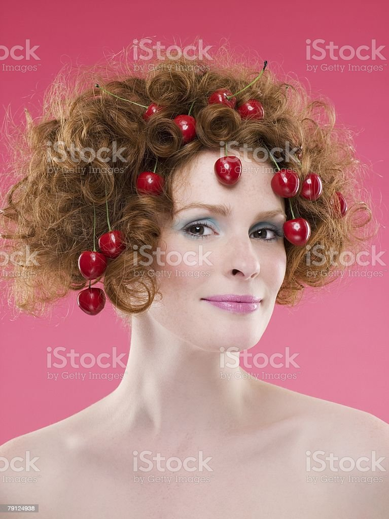 Woman with cherries in hair royalty-free 스톡 사진