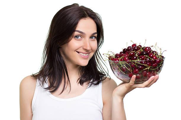 woman with cherries stock photo