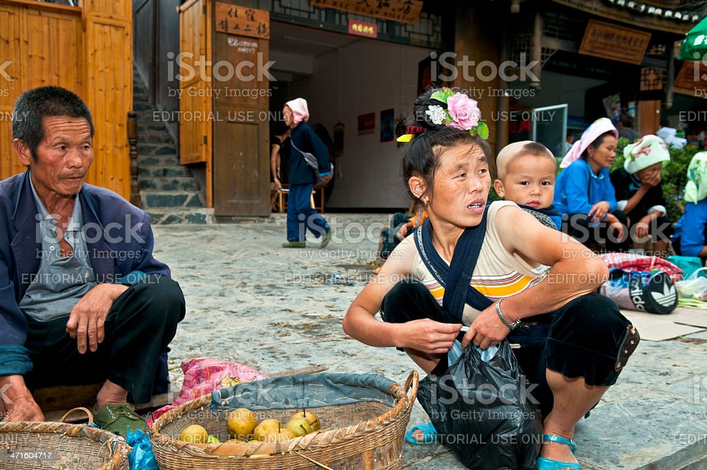 Woman with Child at Miao Market in China royalty-free stock photo