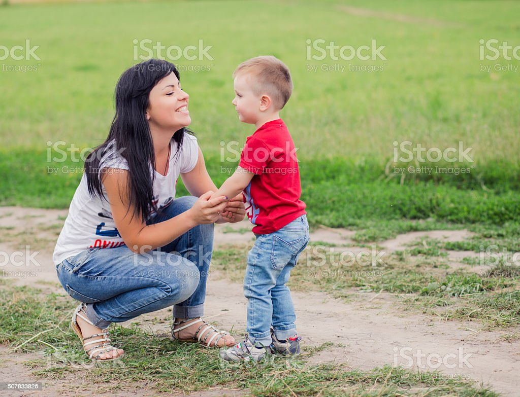 Woman with child in field stock photo