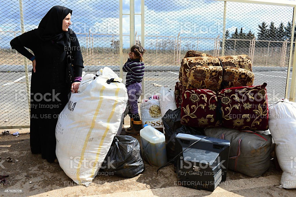 Woman with child - refugees from Syria stock photo