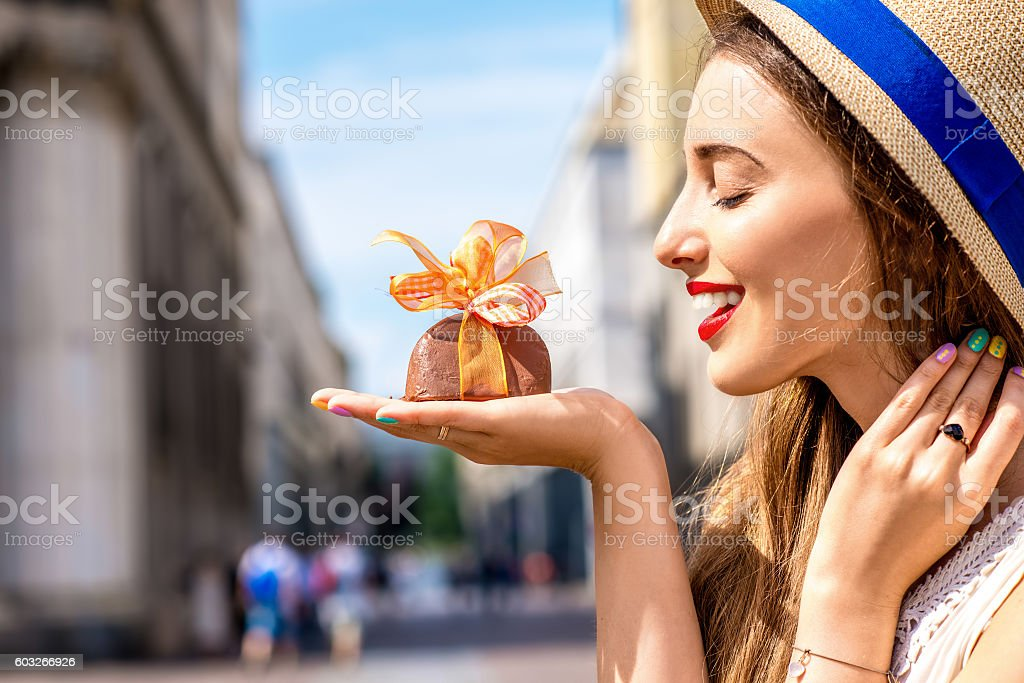 Woman with chocolate in Turin city