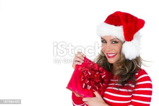 455111881istockphoto woman with christmas gift 187564452