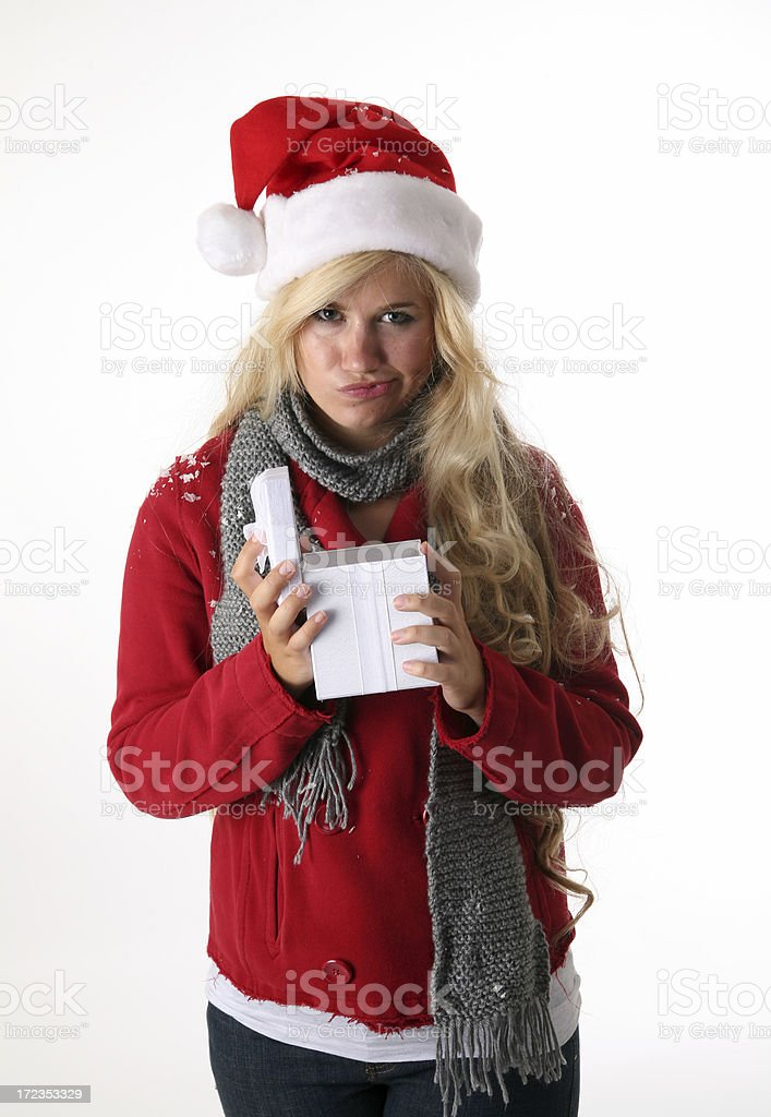 Woman with Christmas gift unhappy royalty-free stock photo