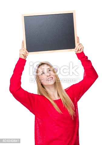 istock Woman with christmas hat and hold up with chalkboard 524540641