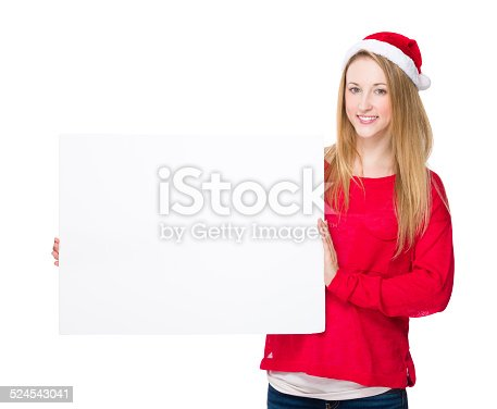 istock Woman with christmas hat hold with blank white board 524543041