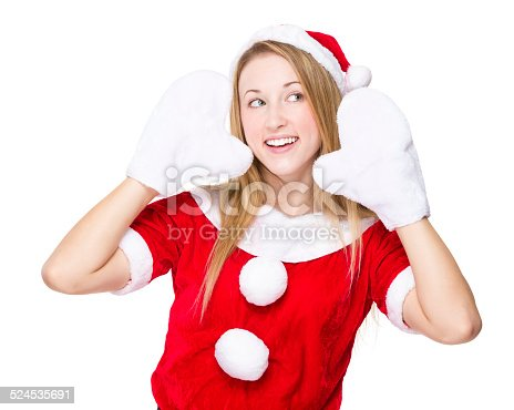 istock Woman with christmas party dress and listen something 524535691