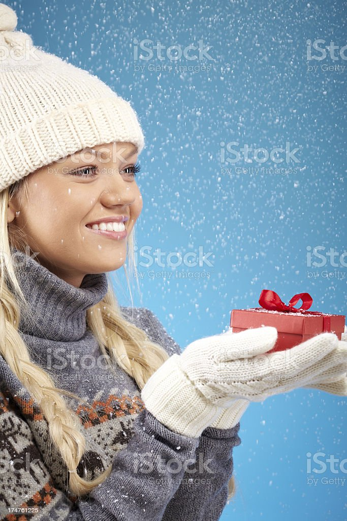 Woman with Christmas present royalty-free stock photo