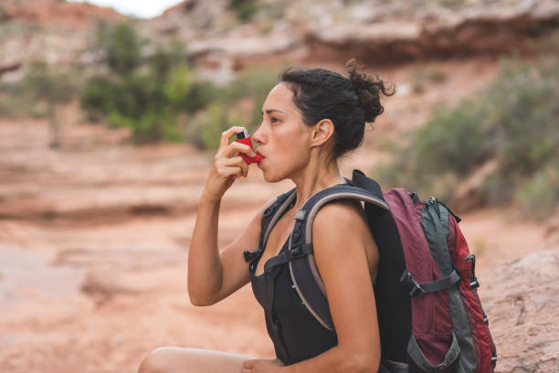 Woman With Chronic Asthma Hiking in Desert stock photo