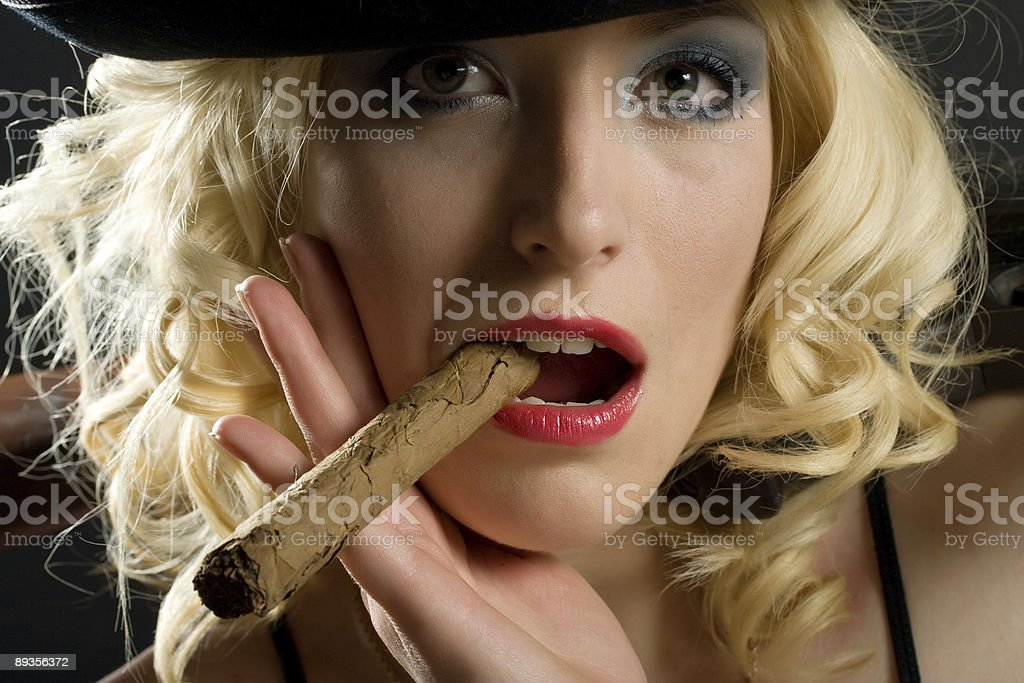 Woman with cigar royalty free stockfoto