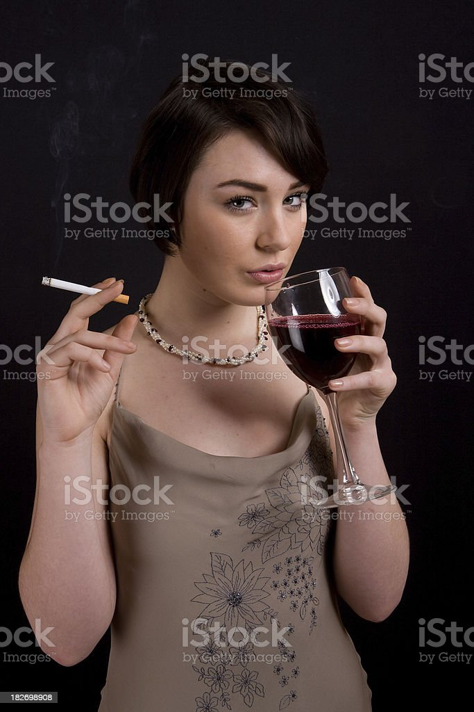Woman with cigarette and glass of red wine stock photo