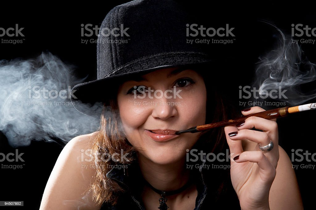 Woman with cigarette holder royalty-free stock photo