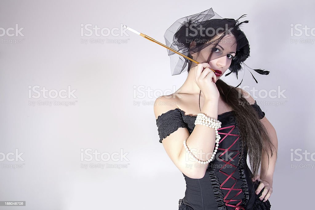 woman with cigarette holder. retro style stock photo